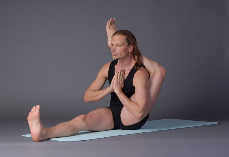 Leg-behind-head postures: importance and warm-ups